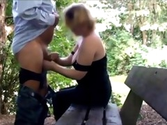 Mature does dogging in a park with a stranger